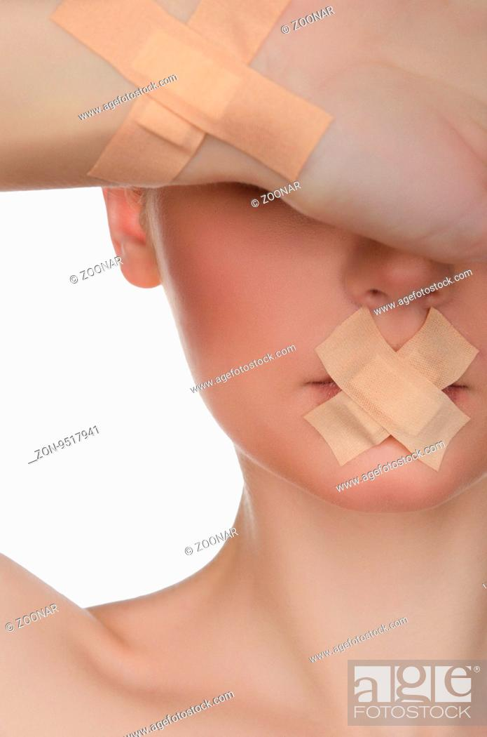 Stock Photo: face of beautiful european woman with medical patch.