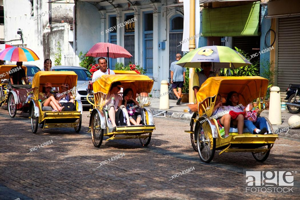 Stock Photo: A Rickshaw Ride in the Streets of Georgetown, Penang.