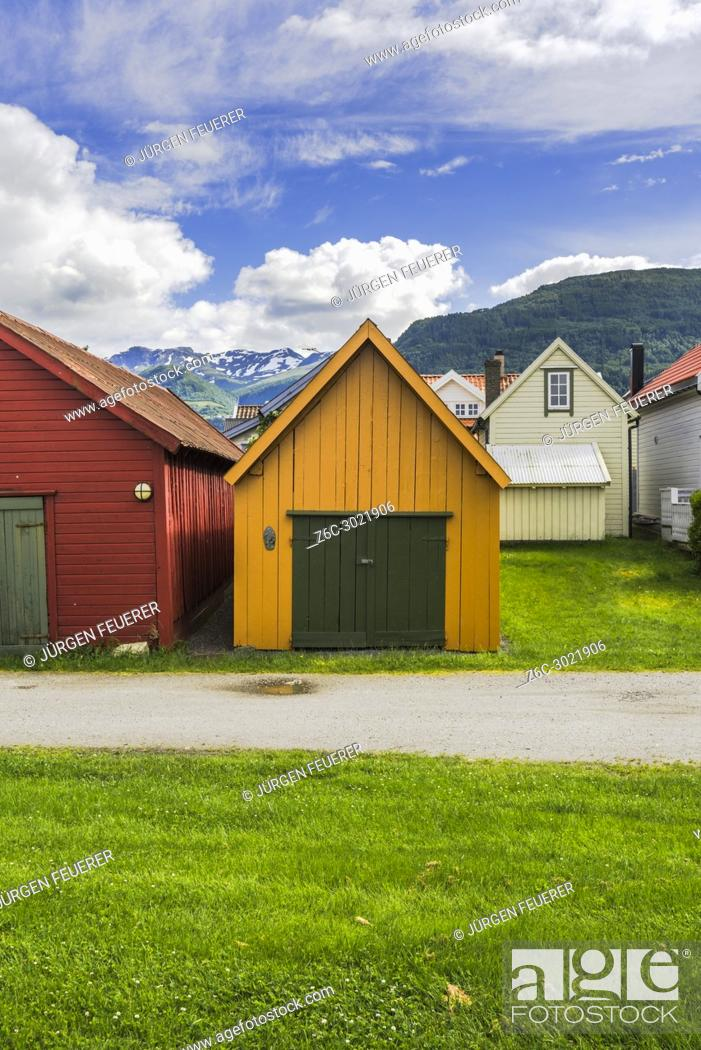 Stock Photo: colourful boathouses and mountain view, Norway, wooden huts in Vik i Sogn, Sognefjorden.