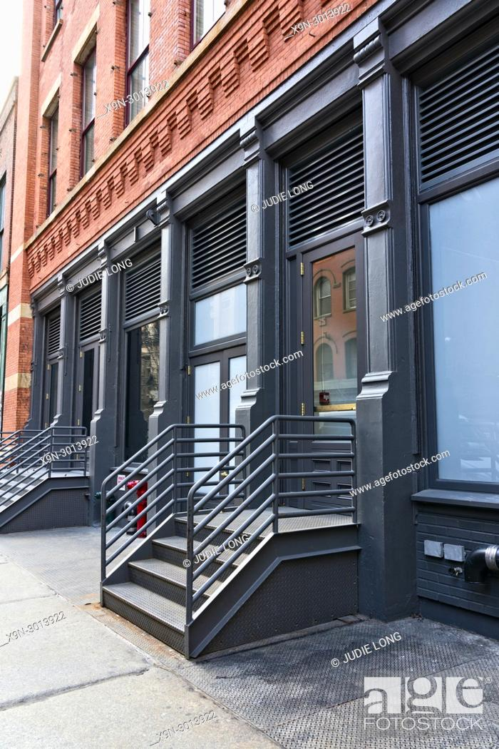 Stock Photo: New York City, Manhattan, Soho. Looking at a Typical Cast Iron Building and a Store with a Cast Iron Stairway.