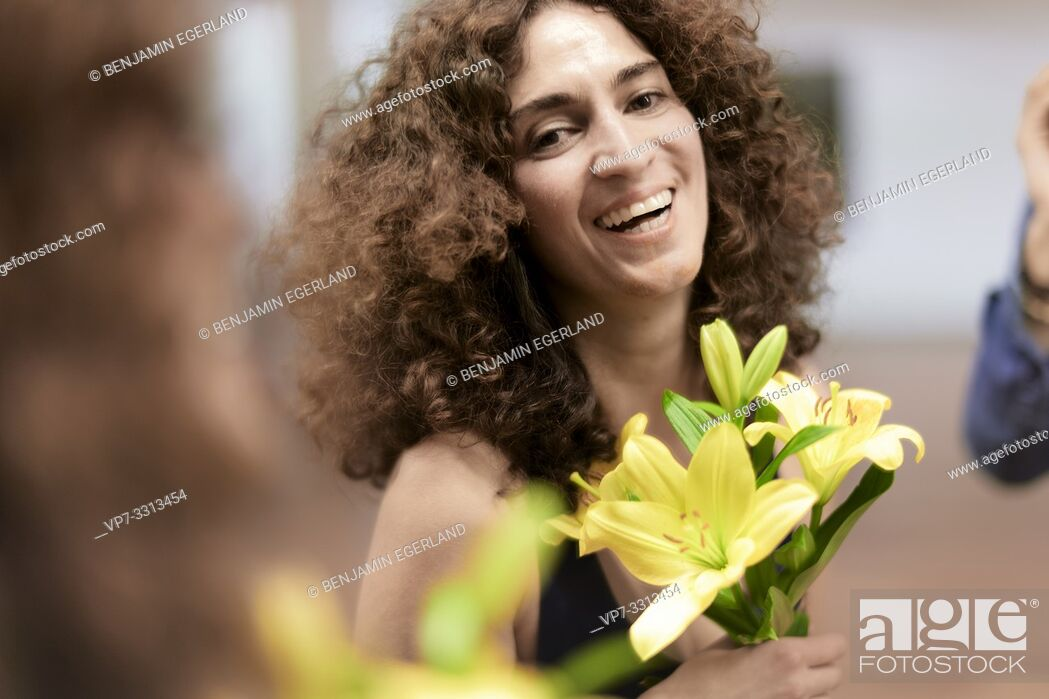 Stock Photo: sporty woman with flowers, happy.