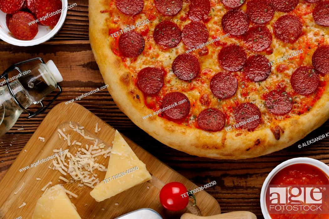Stock Photo: Pepperoni pizza with ingredients.