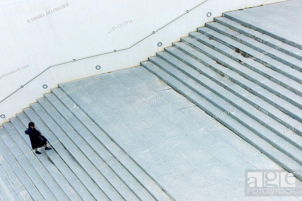 Stock Photo: woman walking up stairs, Ciudad e las Artes y las Ciencias, Valencia, Spain.