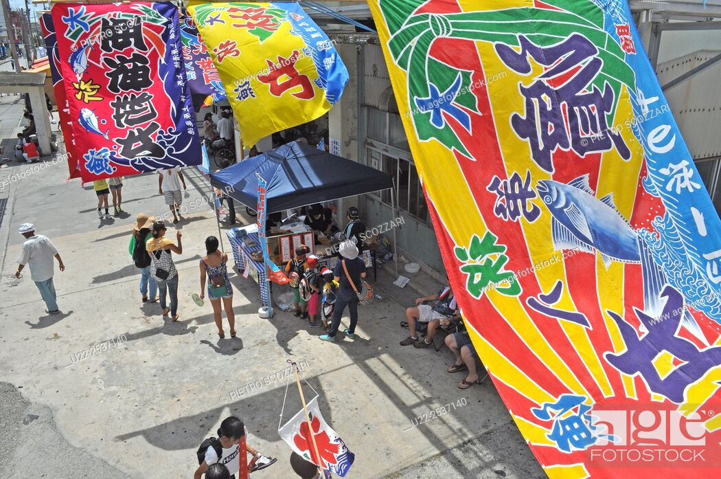 Stock Photo: Itoman, Okinawa, Japan: banners during the traditional Haarii Boat Festival.