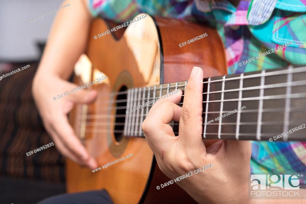 Stock Photo: Bearded hipster man hand playing acoustic guitar. Close-up selective focus on hand.