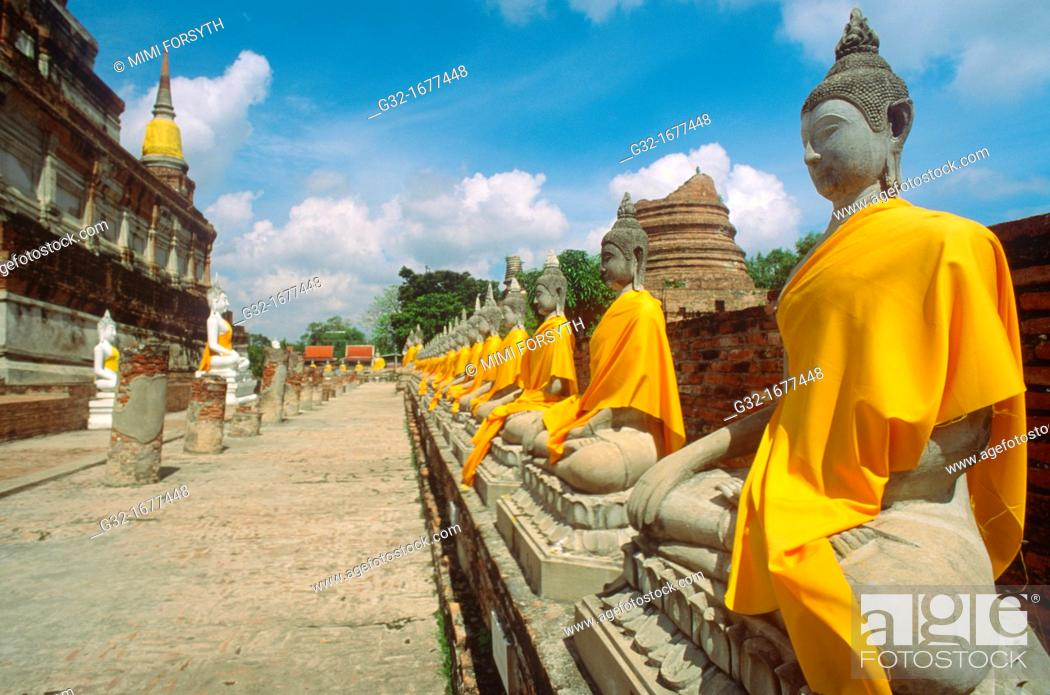 Stock Photo: Buddhas, Ayutthaya, Thailand, draped in gold cloth on eve of Buddha's birth.