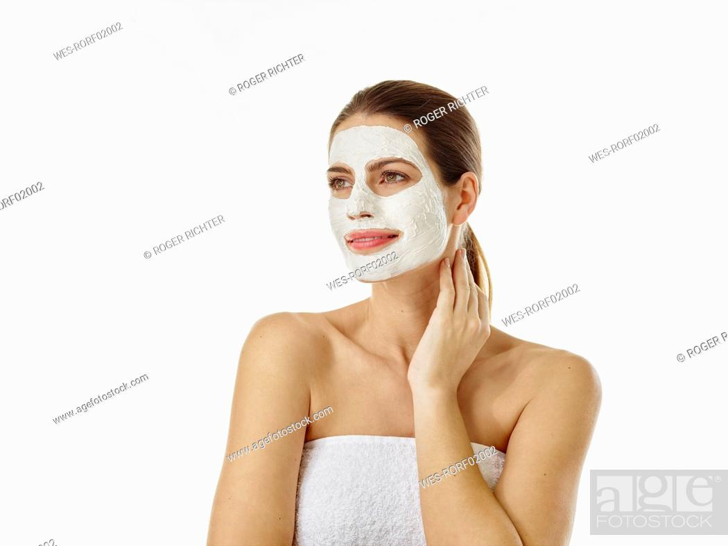Stock Photo: Portrait of smiling woman with beauty mask in front of white background.