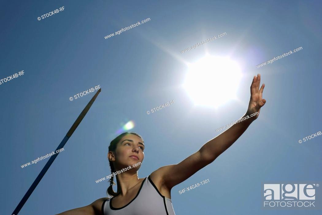 Stock Photo: Woman throwing javelin.
