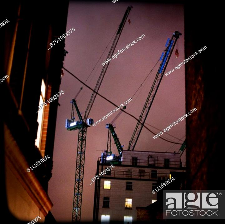 Stock Photo: Cranes and buildings.