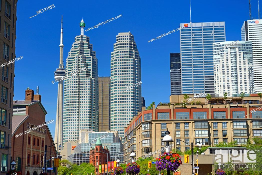 Stock Photo: St Lawrence Market and Gooderham Flatiron building with financial district bank towers and CN tower Toronto.