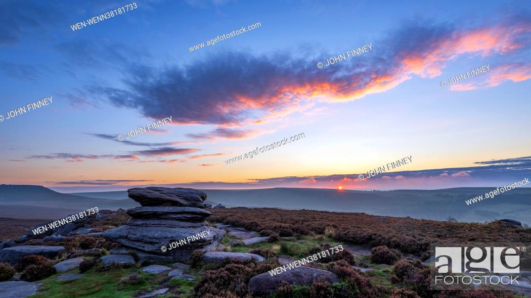 Stock Photo: September sunrise taken on Over Owl Tor on the hills above Hathersage in the Derbyshire Peak District National park. Featuring: September sunrise on Over Owler.
