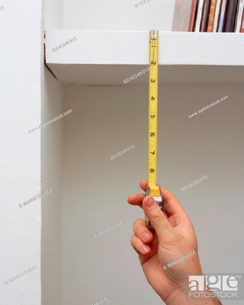 Stock Photo: Measuring shelf height.