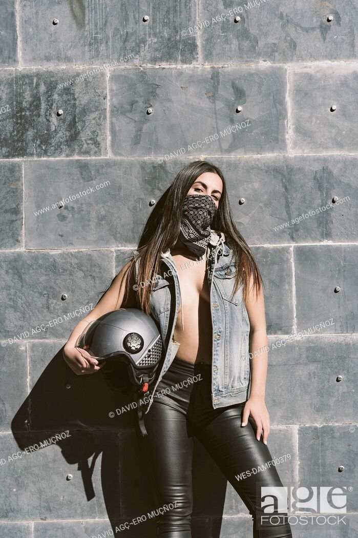 Photo de stock: Portrait of sexy young woman posing with motorcycle helmet.