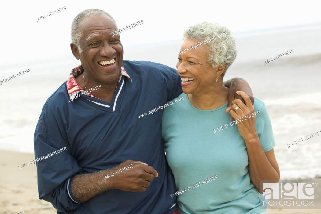 Stock Photo: Senior couple embracing at beach.