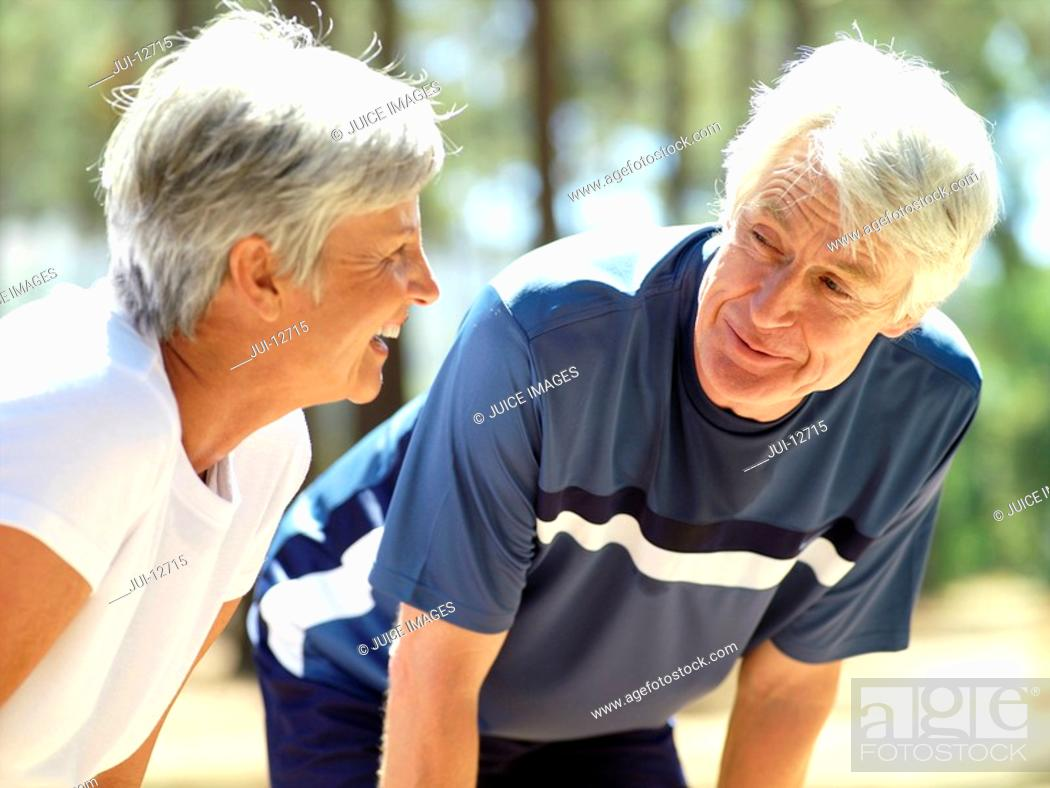Stock Photo: Senior couple smiling at each other, close-up.