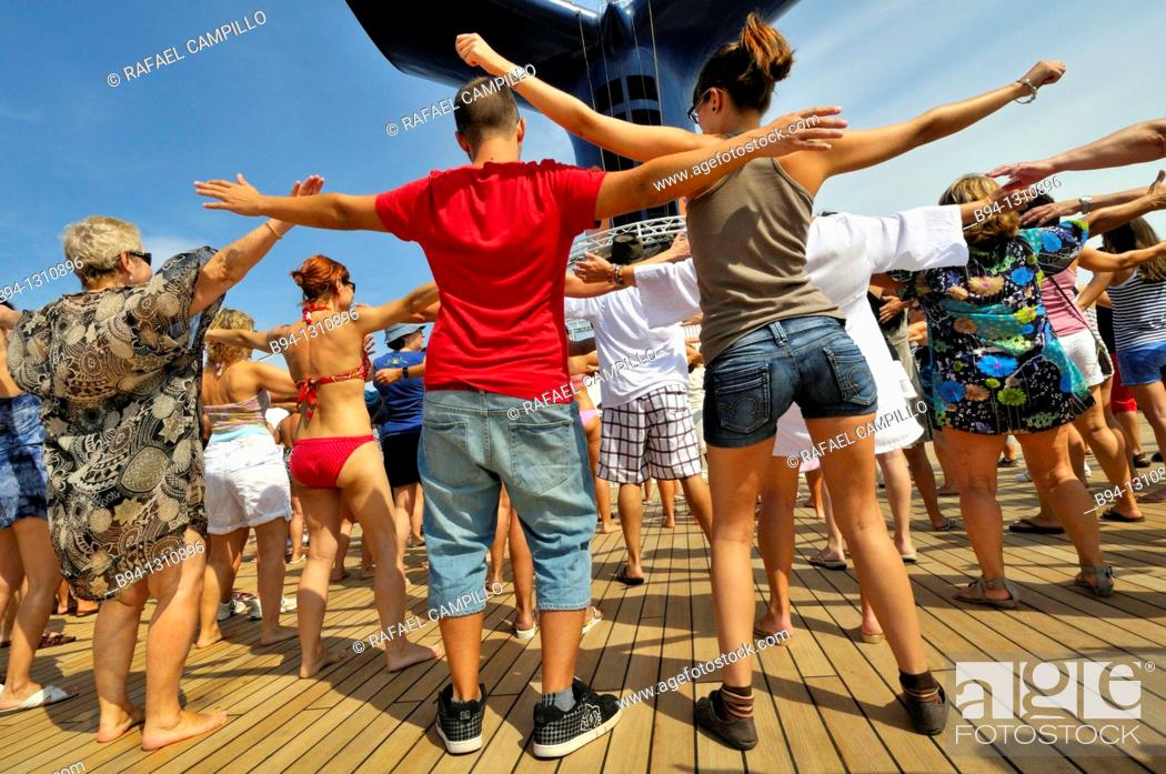 Stock Photo: Passengers dancing on the deck of a cruise ship.