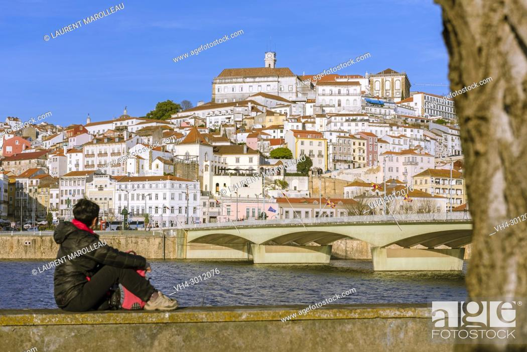 Imagen: Woman Watching the University Town of Coimbra with Mondego River and Santa Clara Bridge. Coimbra, Baixo Mondego, Centro Region, Portugal, Europe.