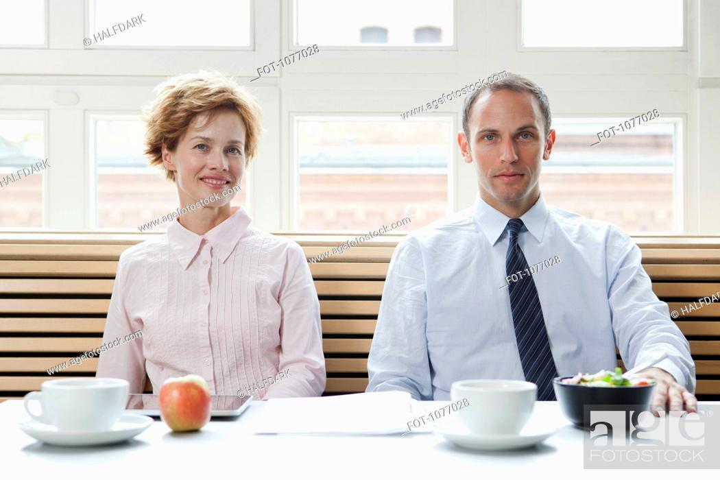Stock Photo: Business colleagues having a business lunch.