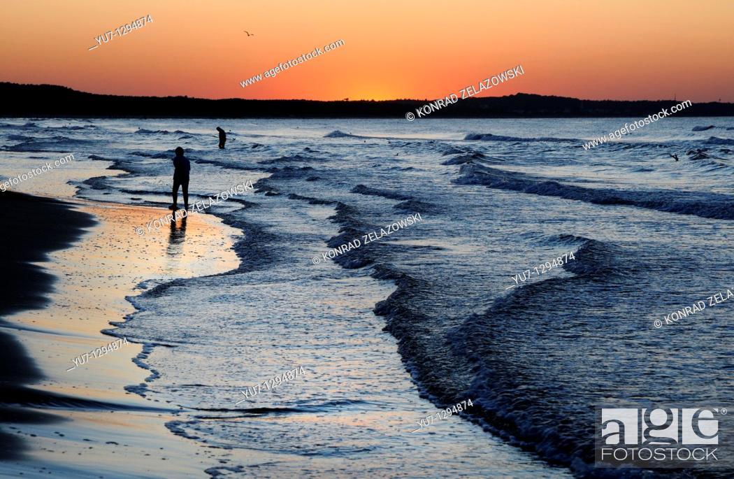 Stock Photo: Sunset over Baltic Sea in Swinoujscie, Poland.