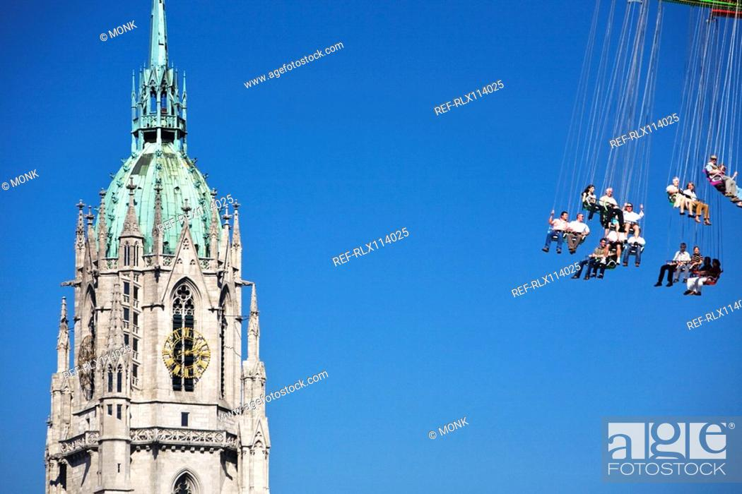Stock Photo: Steeple of St Paul's church with carousel, Oktoberfest, Munich, Germany.
