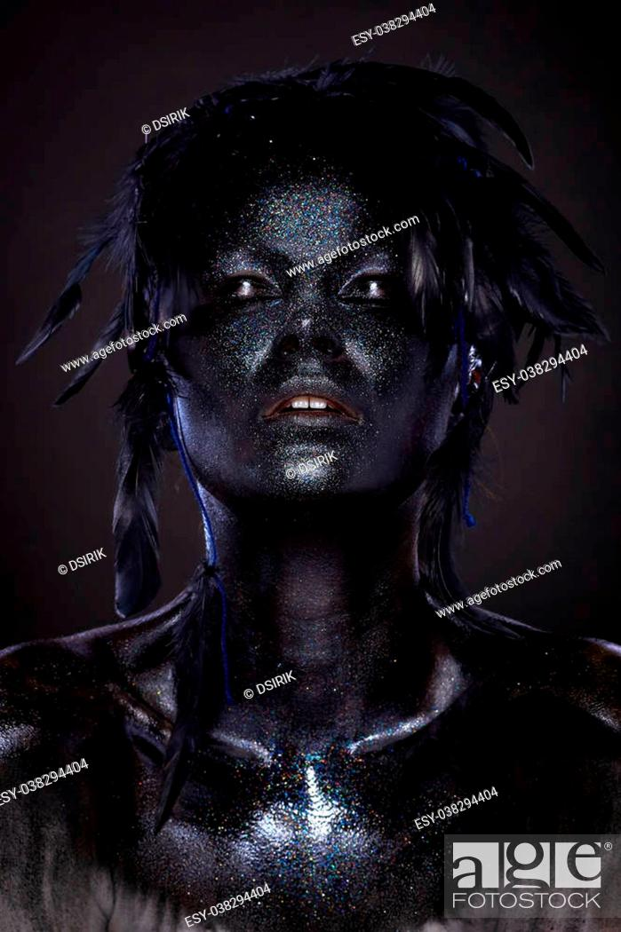 Beautiful Woman With Black Face Over Black Background Creative Body Art Dark Feathers On Head Stock Photo Picture And Low Budget Royalty Free Image Pic Esy 038294404 Agefotostock
