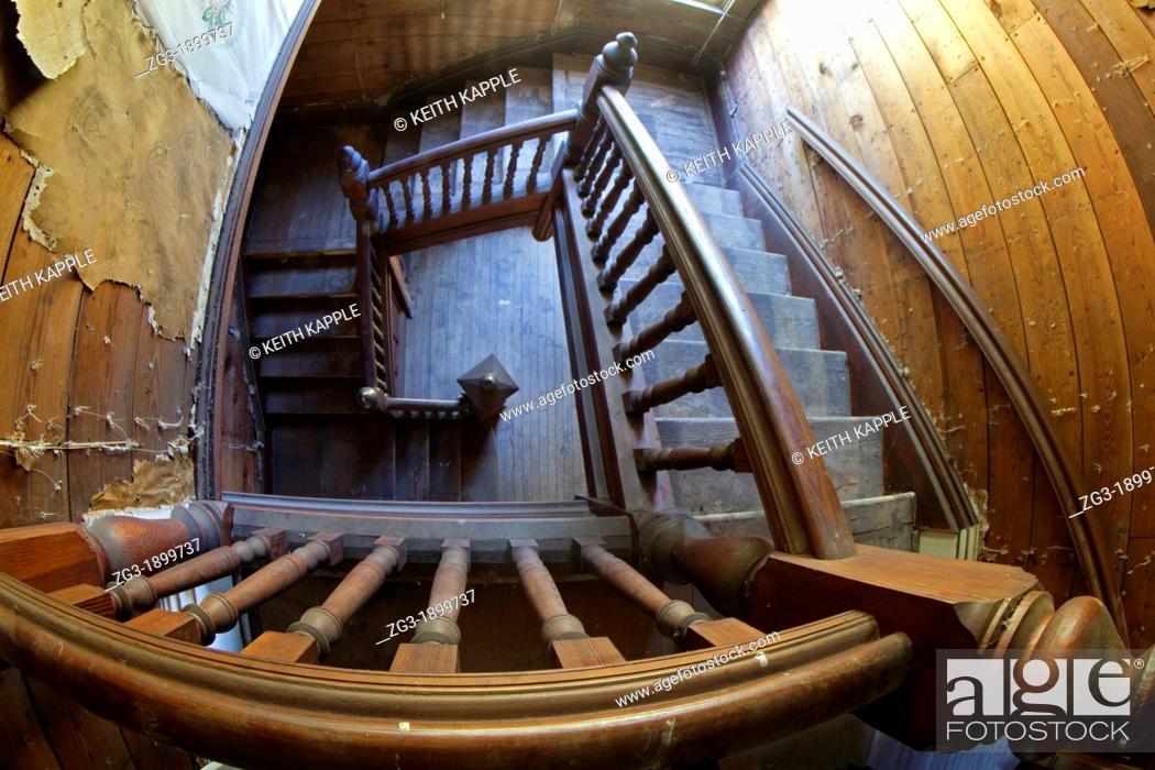 Stock Photo: Interior of an old staircase in an abandoned Victorian era home, 1887, Calvert, Texas.