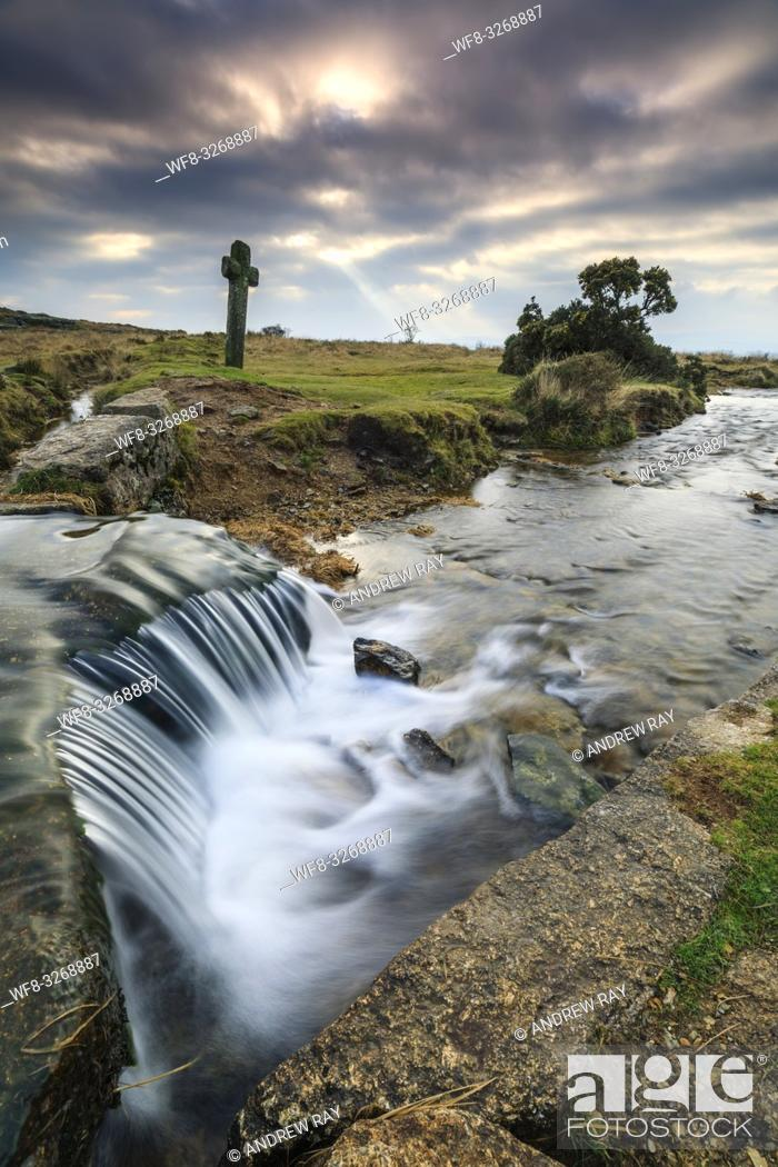 Stock Photo: A waterfall on the Devonport Leat at Windy Post in the Dartmoor National Park. A long shutter speed was utilised to blur the movement in the water coming over.