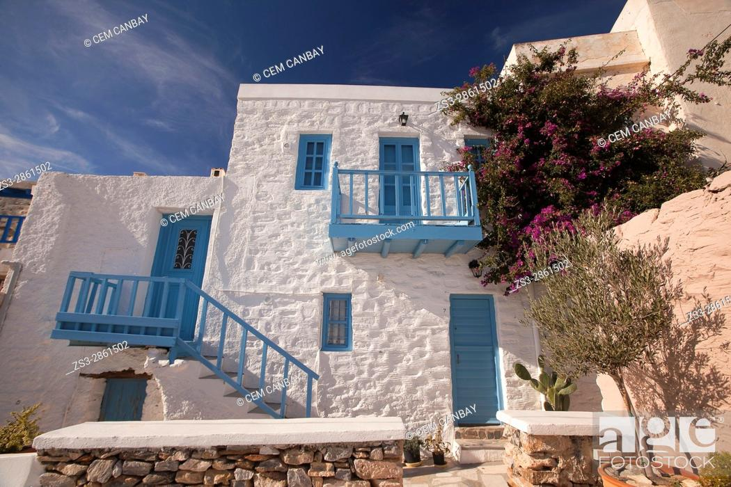 Stock Photo: Facade of a whitewashed house with blue balcony, railings and windows in Ano Syros village, Syros, Cyclades Islands, Greek Islands, Greece, Europe.