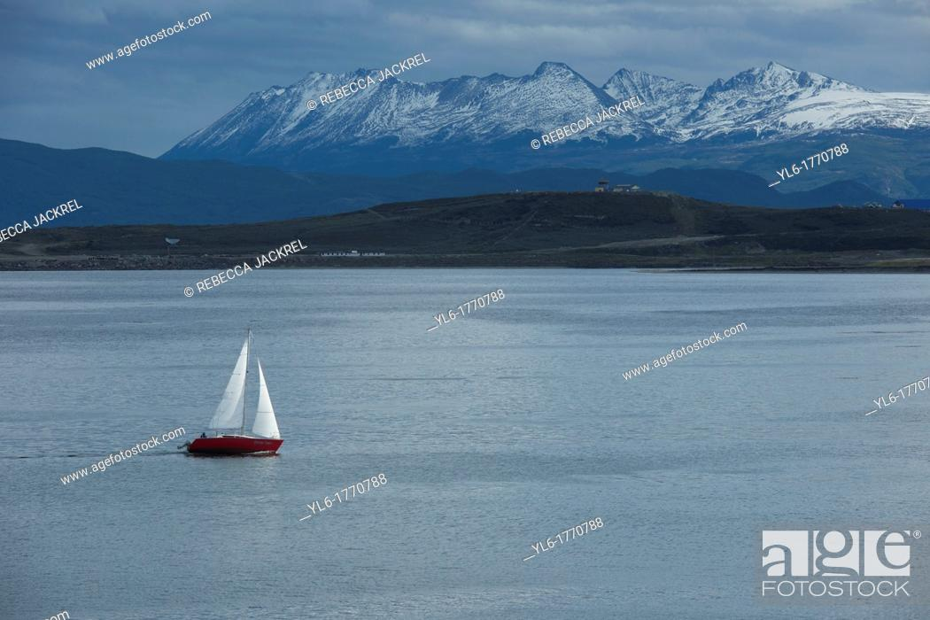 Stock Photo: A sailboat plies the waters of the Beagle Channel, Tierra del Fuego, Argentina.