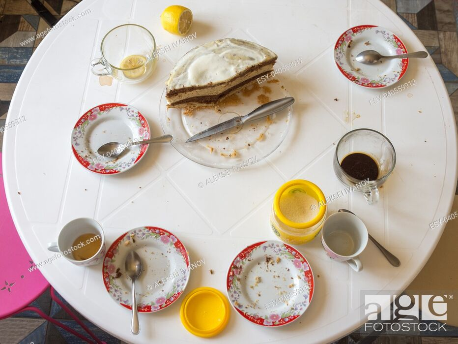 Photo de stock: Dirty dishes and half of the homemade cake on the table.