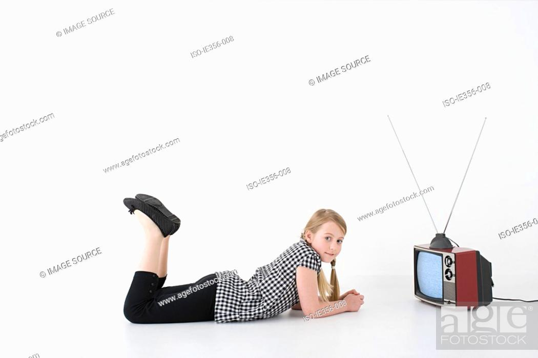 Stock Photo: Girl with television.