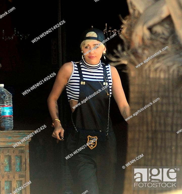 Miley Cyrus Wearing Black Leather Dungarees Accessorised With Chanel Handbag Gold Earrings Stock Photo Picture And Rights Managed Image Pic Wen Wenn21492426 Agefotostock