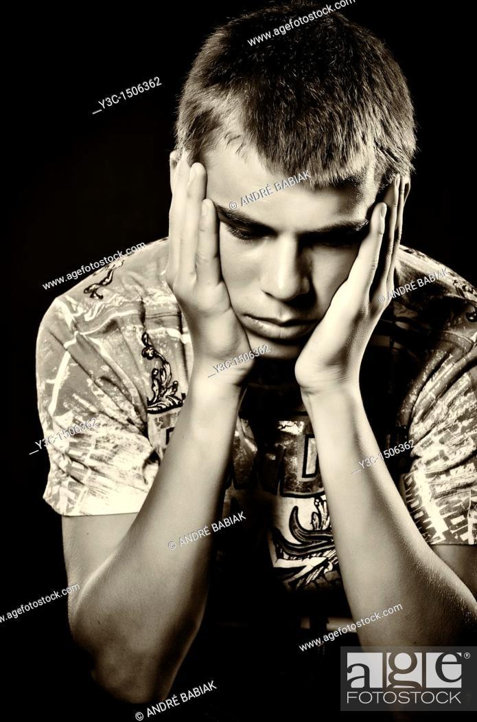 Stock Photo: Dark portrait of hopeless teenager.