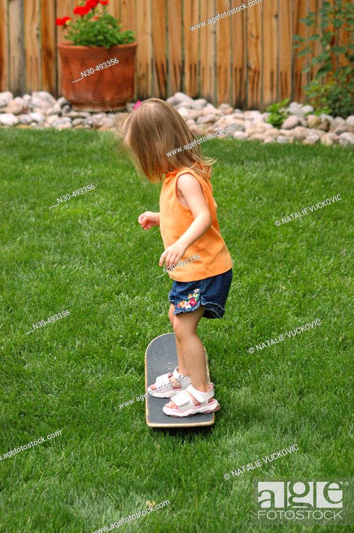 Stock Photo: Toddler on skateboard.