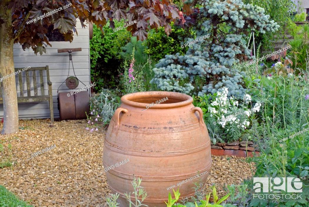 LARGE TERRACOTTA POT IN RUSTIC COUNTRY GARDEN, Stock Photo