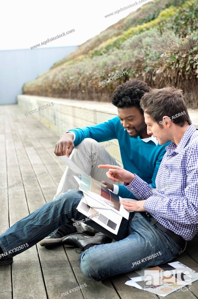 Stock Photo: Friends choosing color swatches.