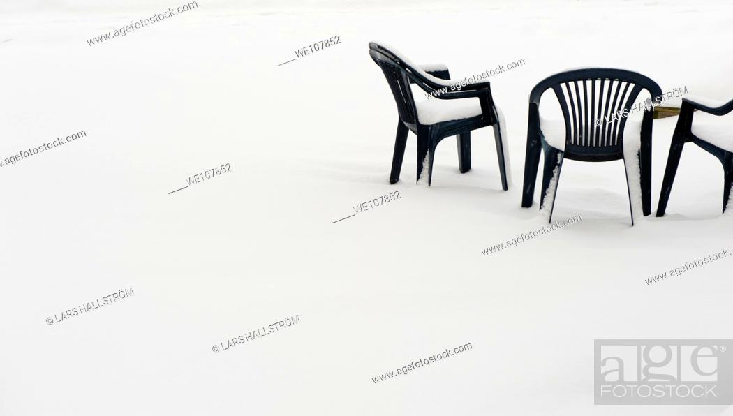 Stock Photo: Chairs covered with snow, Sweden.