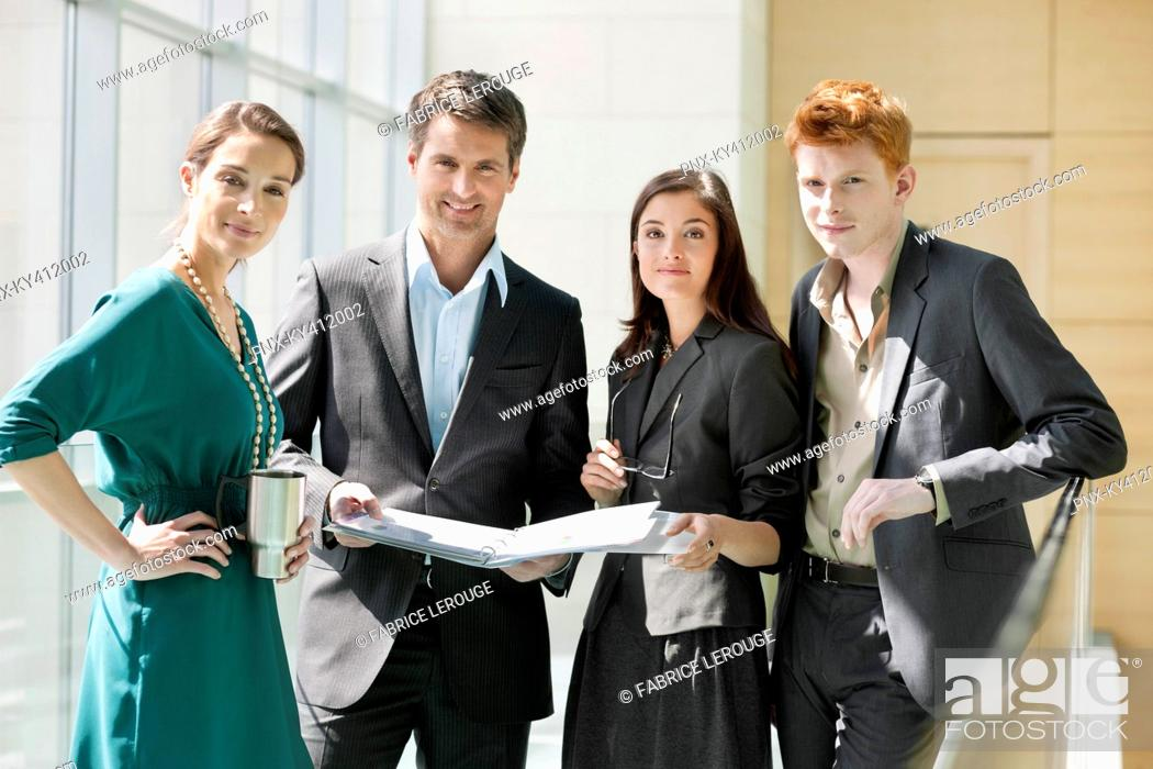 Stock Photo: Portrait of business executives working in an office.