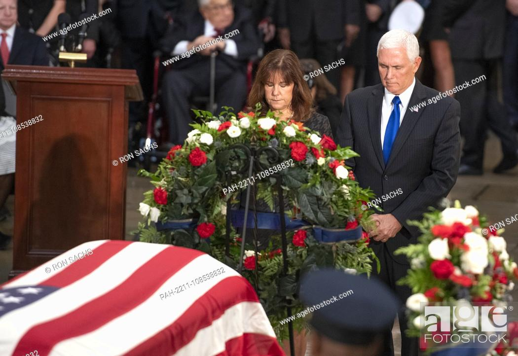 Stock Photo: United States Vice President Mike Pence, right, and Karen Pence, left, lay a wreath during the Lying in State ceremony honoring the late United States Senator.