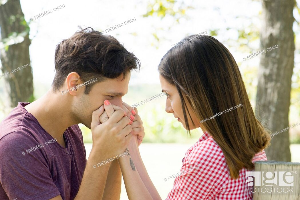 Stock Photo: Man kissing wife's hand.