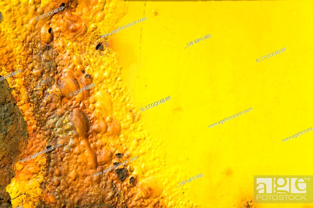 Stock Photo: Detail of scorched yellow plastic.