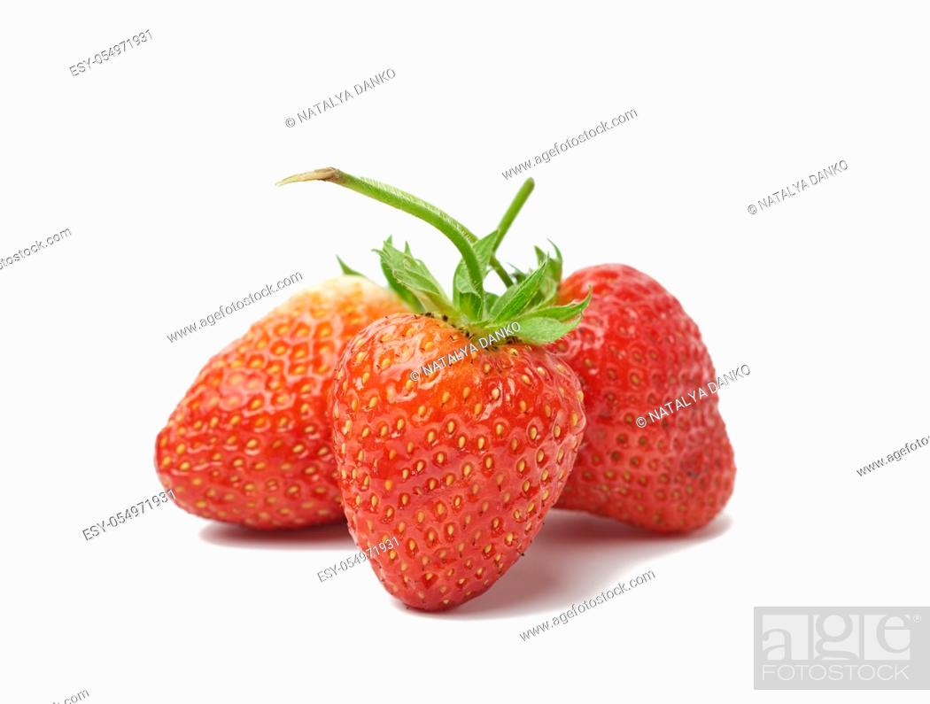 Stock Photo: whole ripe red strawberries isolated on a white background, close up.
