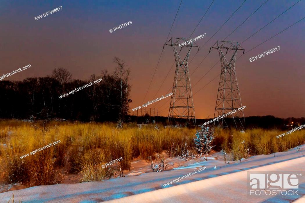 Stock Photo: Industrial landscape - illuminated railway station by winter night with snowfall Winter night road power lines.