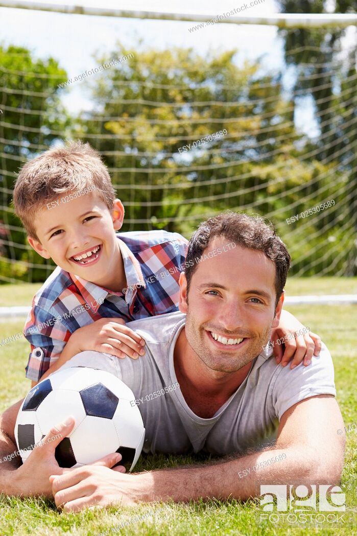 Stock Photo: Portrait Of Father And Son With Football.