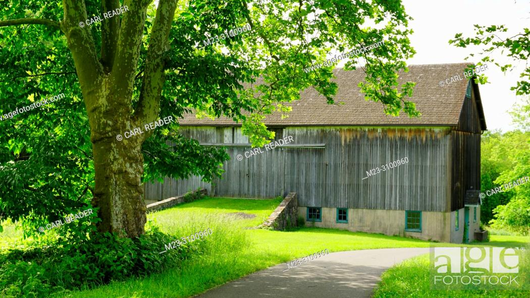 Stock Photo: An old barn by a path in summer, Pennsylvania, USA.