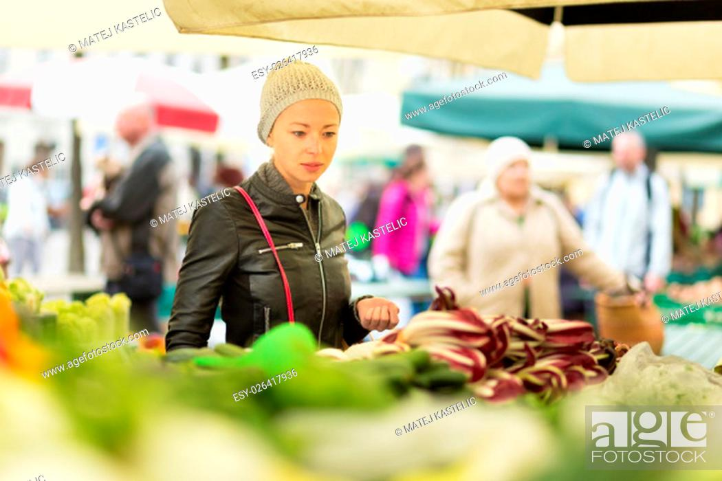 Stock Photo: Woman buying fruits and vegetables at local food market. Market stall with variety of organic vegetable.
