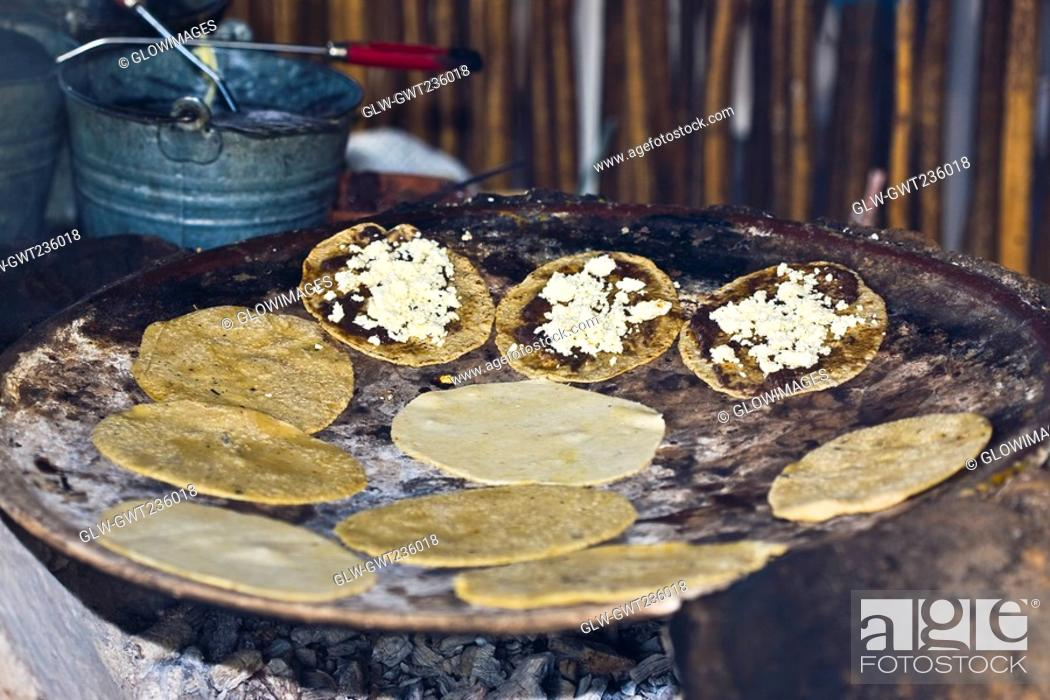 Stock Photo: Tortilla preparing on the griddle, Santo Tomas Jalieza, Oaxaca State, Mexico.