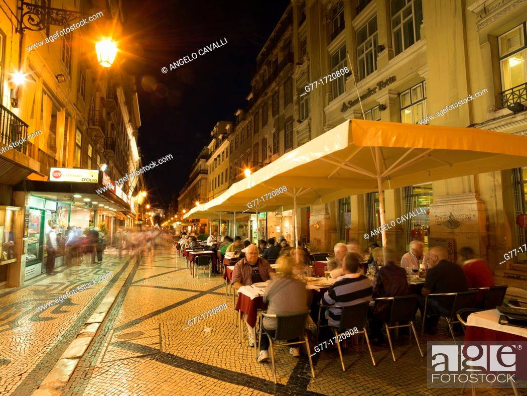 Stock Photo: Portugal Lisbon. People in outdoor restaurant in Rua Augusta at evening.