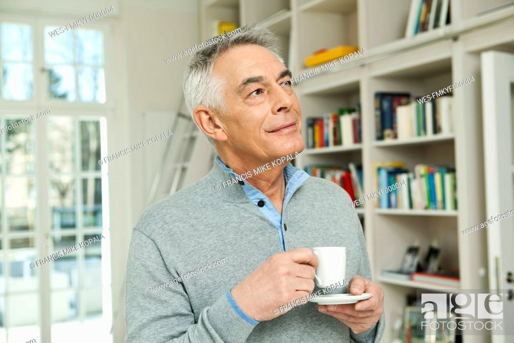 Stock Photo: Germany, Berlin, Senior man with coffee cup.
