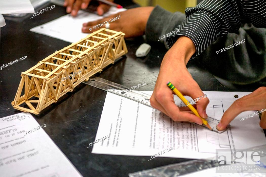 Stock Photo: A high school student in Mission Viejo, CA, makes a mechanical drawing of a structural bridge model in a conceptual physics class.